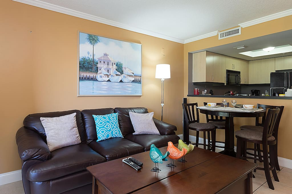 The bright and spacious living room/dining area is perfect for a relaxed evening with family or friends.