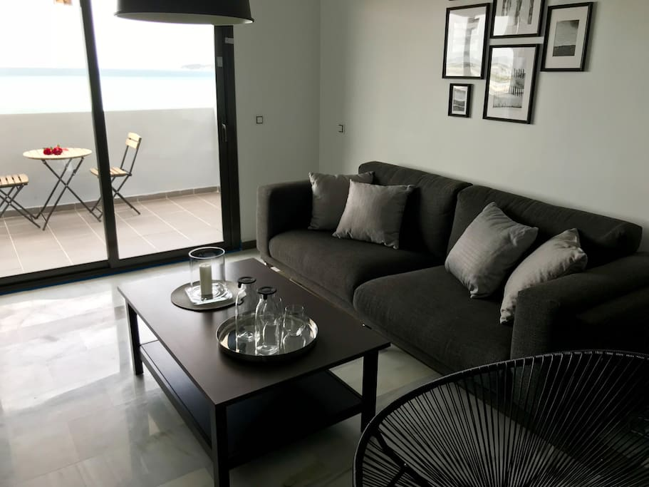 The living room has direct access to the balcony.