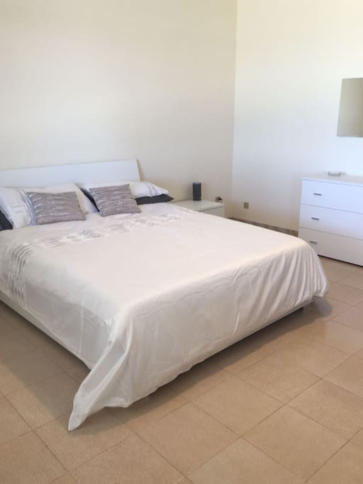 BEDROOM 1- double bed. Swimming pool view.