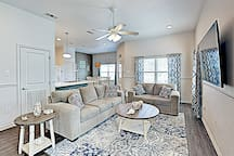 The stylish living area is furnished with a plush sofa and love seat.