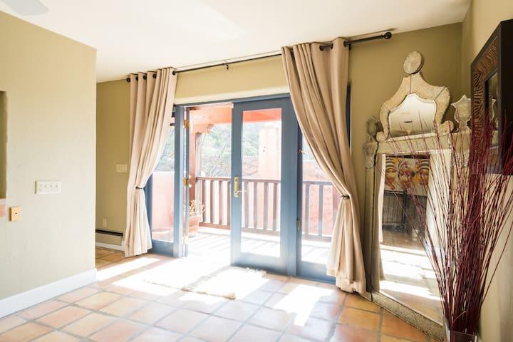 Master suite with balcony overlooking Atrium..