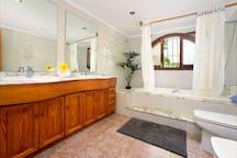 Bathroom 1 of 3, Adjacent to Bedroom 1