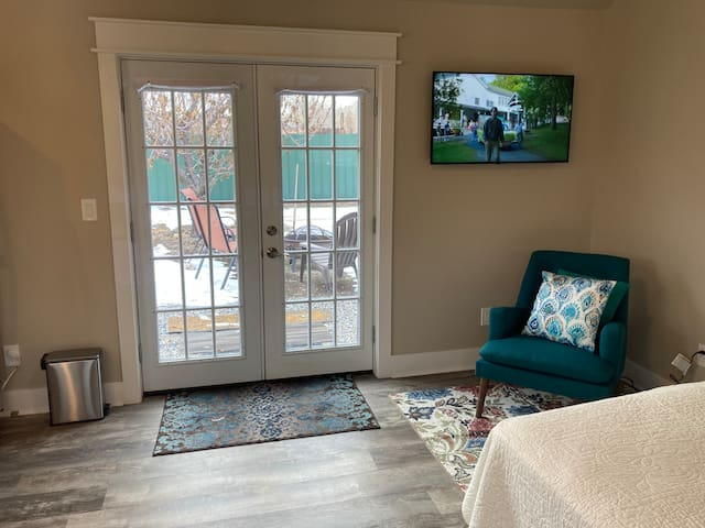 """TV and wifi, little sitting area and French doors outside to """"honey pot"""" and fire pit."""