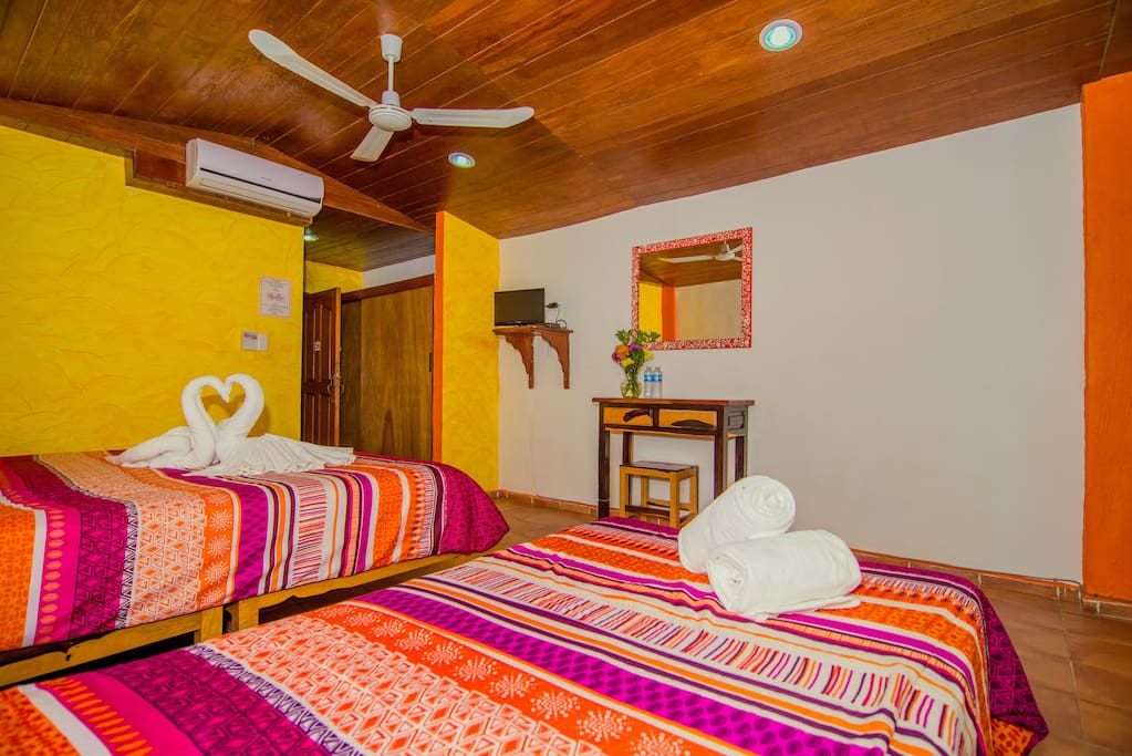Triple room, a/c, ceiling fan, cable tv, wifi, private bathroom with shower