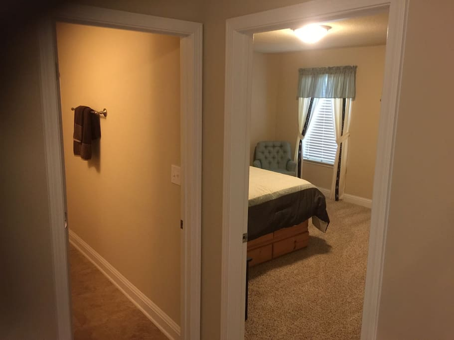 Bedroom is located right next to bathroom