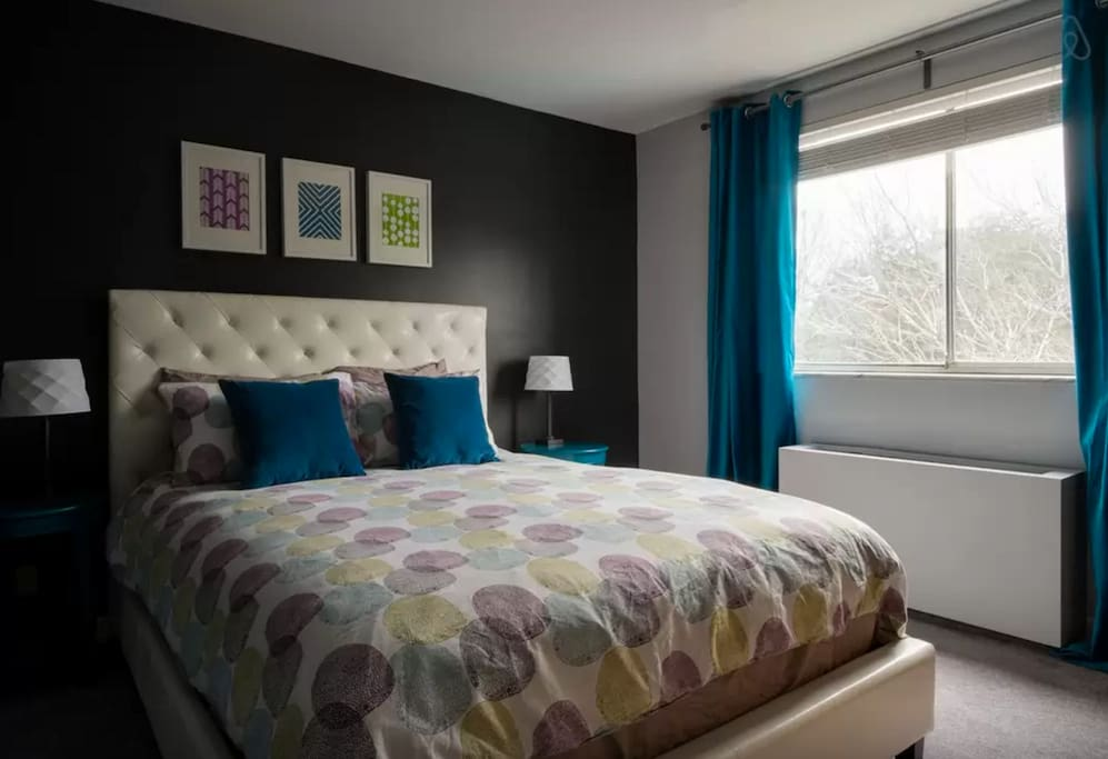 Newly redesigned bedroom with queen pillow top mattress and high quality bedding.