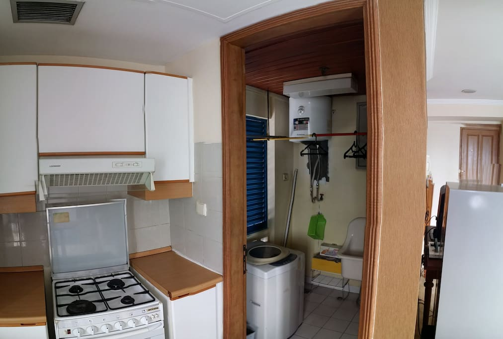 washer dryer and storage room/ iron and ironing board in the bedroom