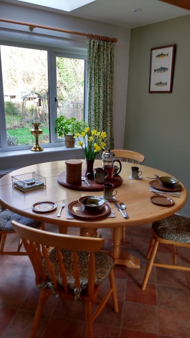 Breakfast in our kitchen where you can enjoy looking onto the garden