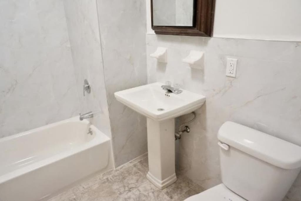 Bathroom with shower and tub (curtain provided)