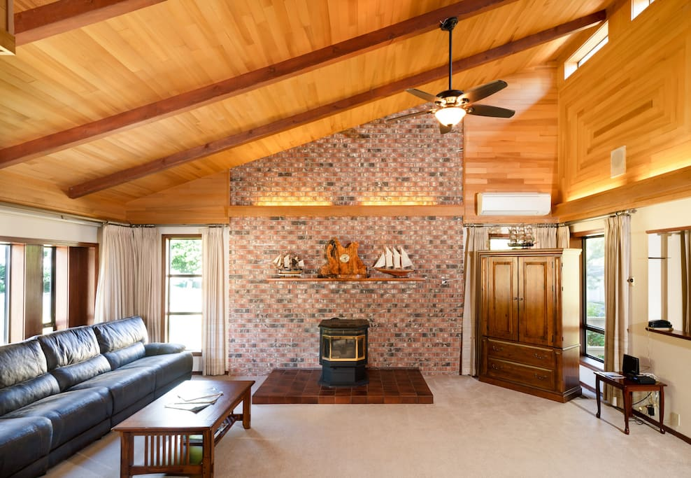 The stone wall in the living room is custom decorated and includes a fireplace. There is also a TV center equipped with a big screen tv and satellite.