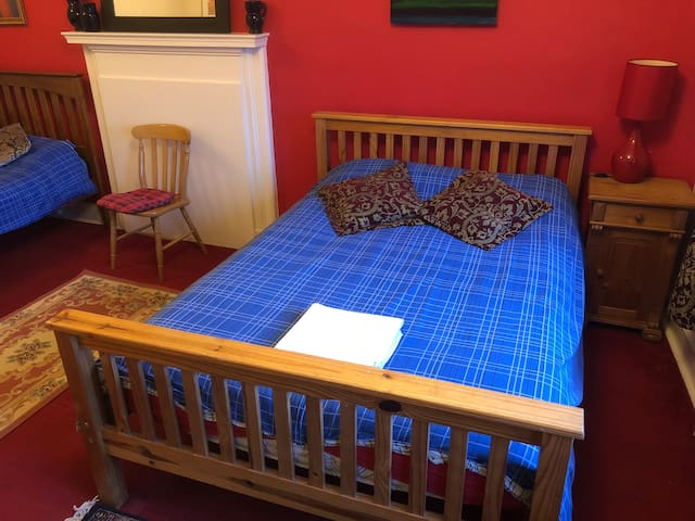 The triple bedroom with 2 King Beds and a Single Bed. Great for families.
