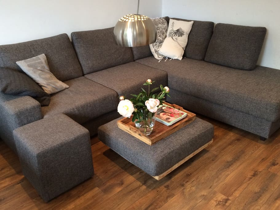 Comfy couch to relax after a day of exploring Amsterdam, also ideal for movie nights.