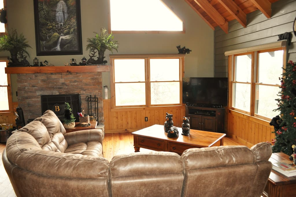 Main level living room with wood burning fireplace