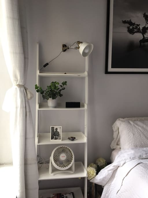 Full charging station and reading lamp with dimmer featured bedside for your comfort.