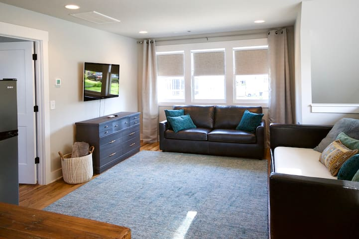 The couch pulls out to a comfortable queen bed, and the day bed includes a trundle, so it can be turned into two twin beds.  We have a Roku so you can sign into whatever streaming video service you use.