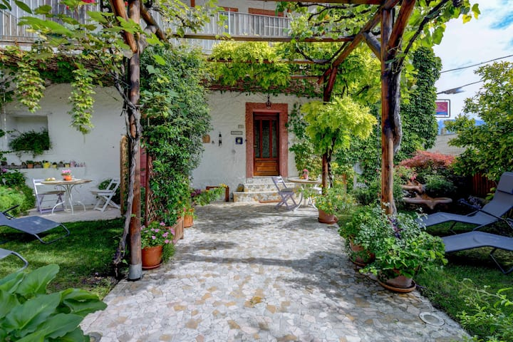 "Rustic and Charming Apartment ""Regina del Lago - Monolocale Magnolia"" High Above Lake Garda with Spectacular Lake View, Garden, Wi-Fi and TV; Parking Available, Breakfast Possible at Extra Charge"