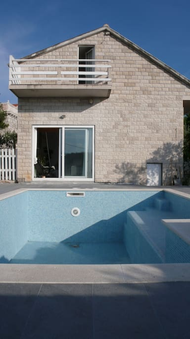 private swimming pool in front of house