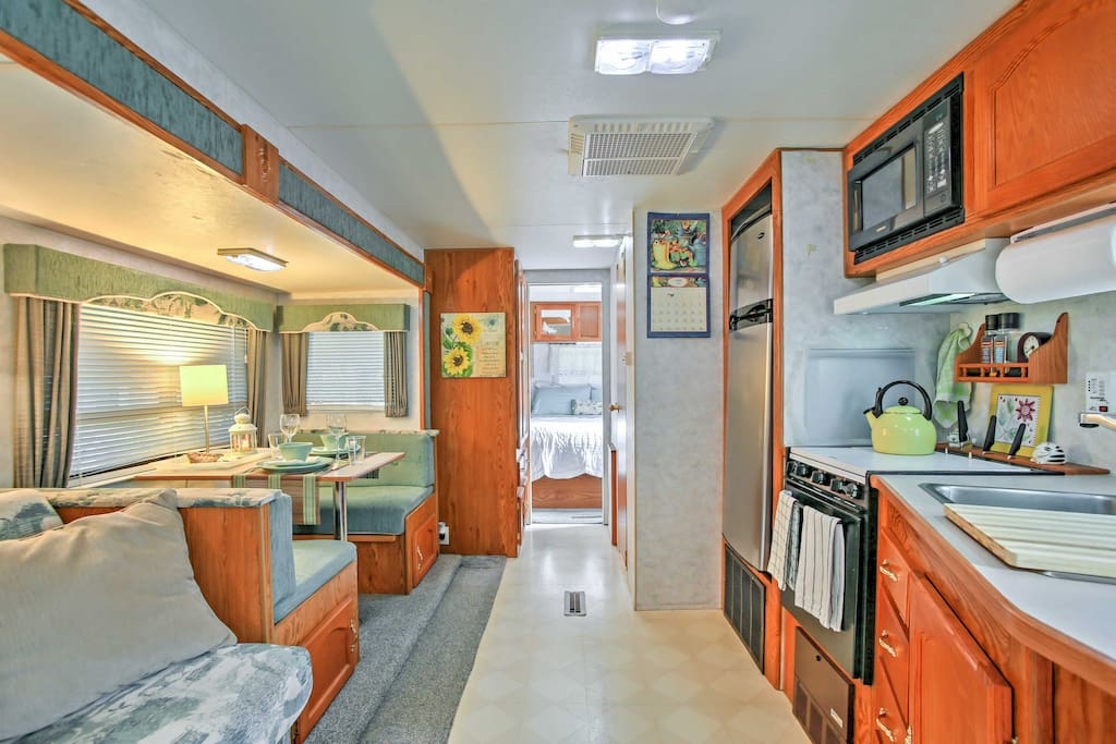 This roomie travel trailer provides all the comfortable amenities of home and in a laid back Florida atmosphere, perfect for a couple's beach vacation!