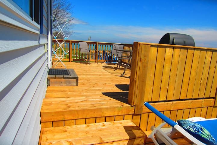 a few steps up to your amazing deck with a fantastic view over West Lake