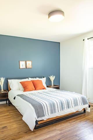 Master bedroom with super comfy memory foam queen bed and ensuite bathroom!