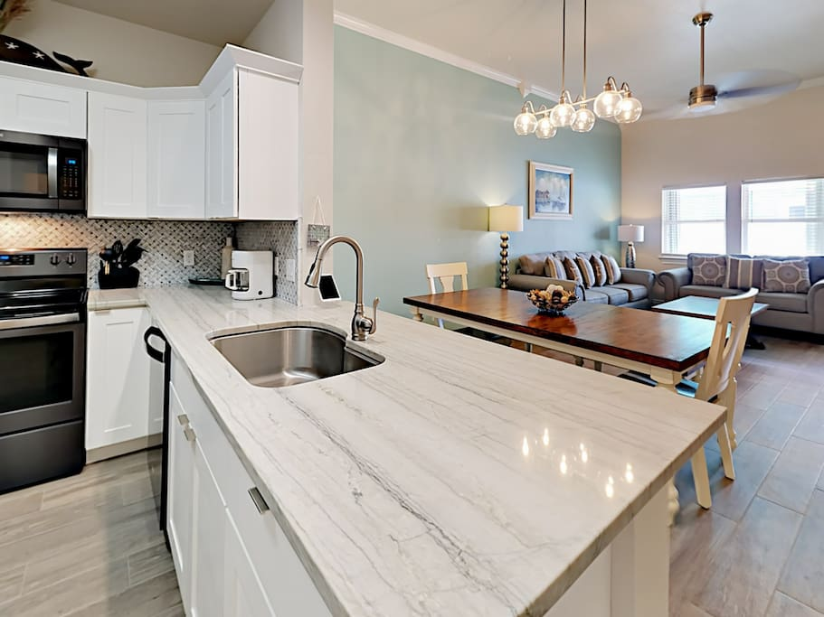 The well-equipped kitchen has ample counter space to work your culinary magic.