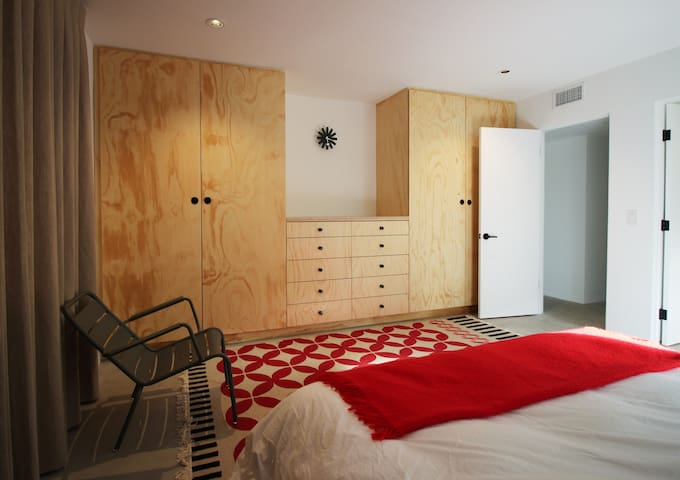 Master bedroom with Douglas Fir plywood closets