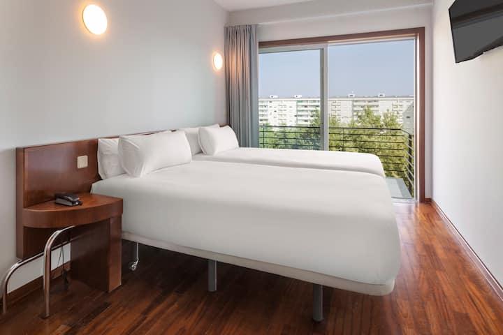 Apartamento 1 dormitorio con dos camas + sofá-cama