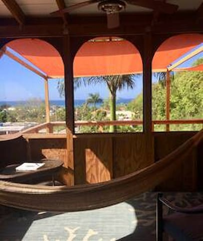 Your private, enclosed porch, equipped with a hammock for your post-surf siesta.