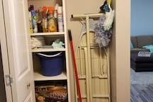 pantry, games, cleaning supplies, ironing board.