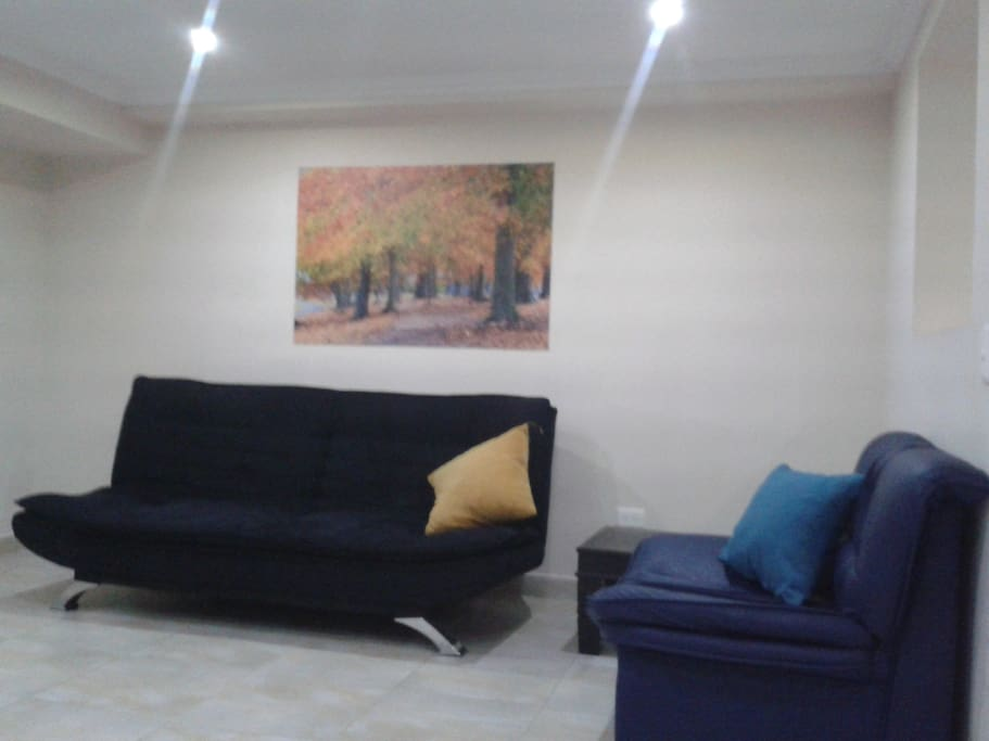 Living area with comfortable sofa and air conditioning