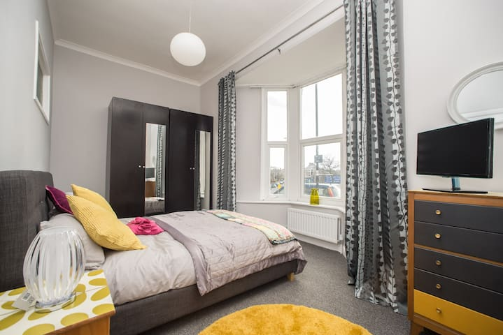 Lovely double bed with double wardrobe and a flatscreen TV.