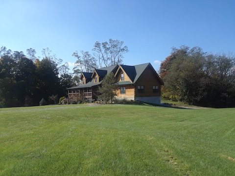 Three Cedar Log Home lighted pear tree driveway
