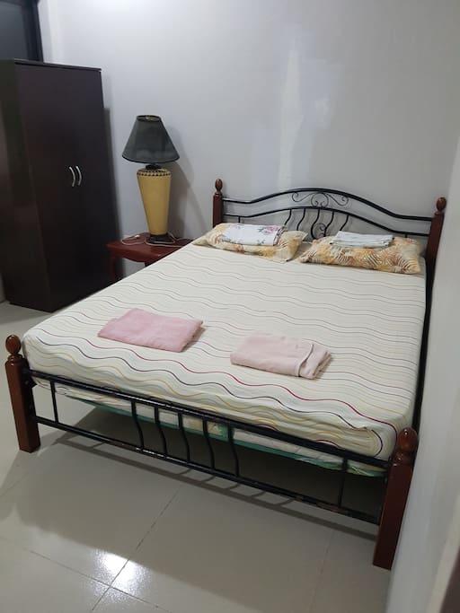 Queen-sized bed arrangement