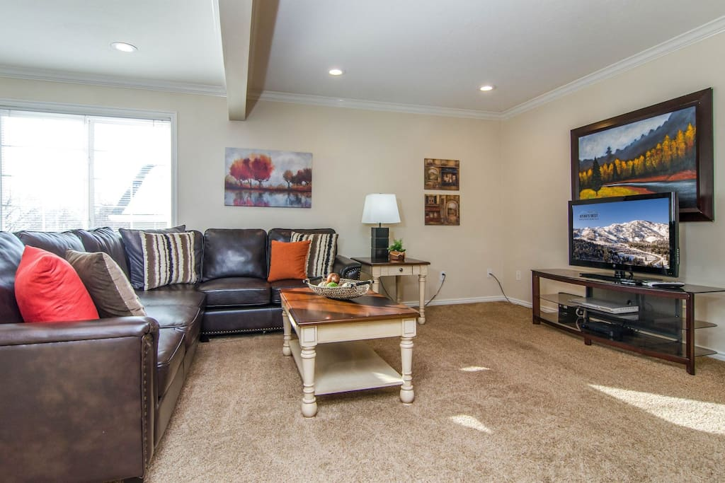Spacious living room with a TV