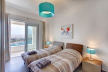Bedroom 2 with two single beds with amazing seaviews
