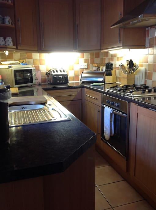 Kitchen, fully equipped with oven, hob, microwave, dishwasher and washing machine