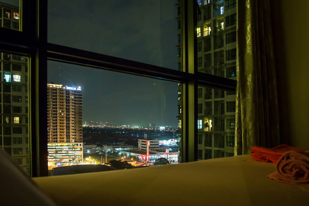 View over a city from the bedroom windows