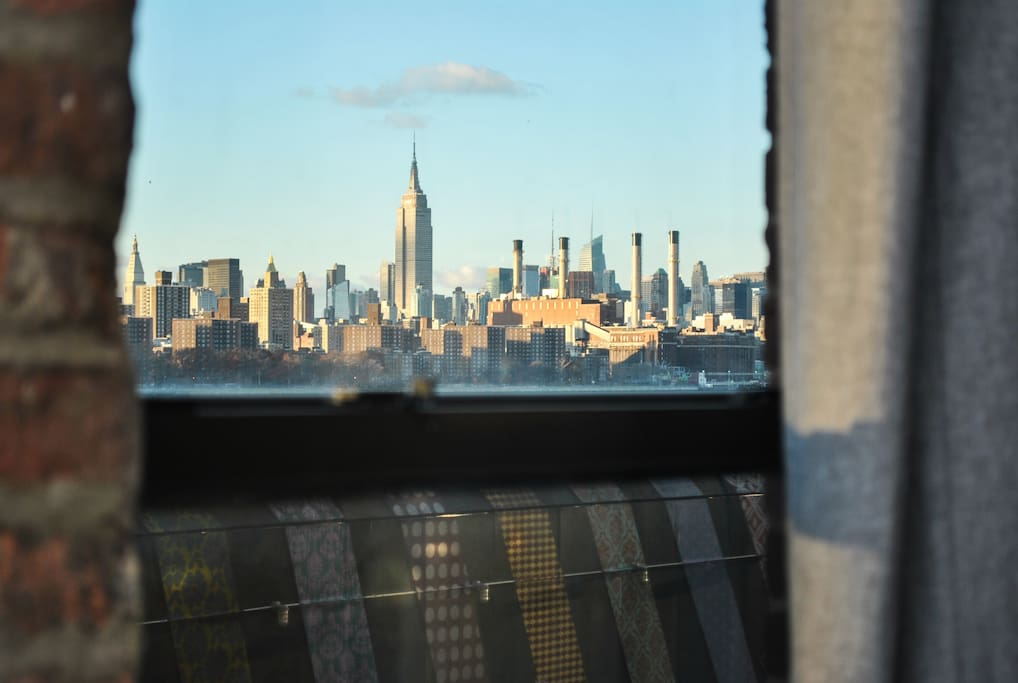 Daytime view of the Empire State Building from your private room.