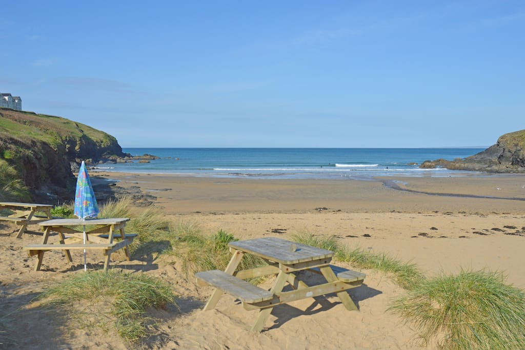 The stunning view of Poldhu Cove from the Beach cafe just one minute's walk from the cottage.