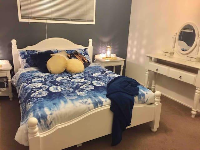 Main bedroom with queen size bed, dressing table and air con.  Room for porta cot also if required.