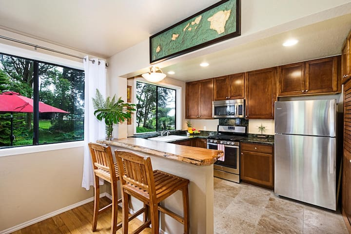 Enjoy expansive garden views -Breakfast bar with fully equipped kitchen