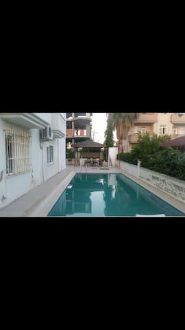 Side havuzlu apart Villa mükemmel bir tatil için