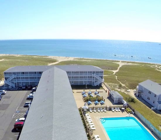 Aerial view of the outdoor pool, private beach and Cape Cod Bay looking south.