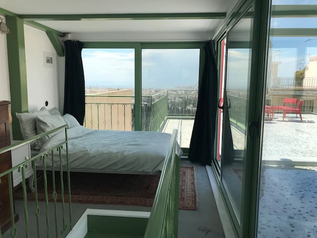 Upper bedroom with incredible view to the sea and acropolis