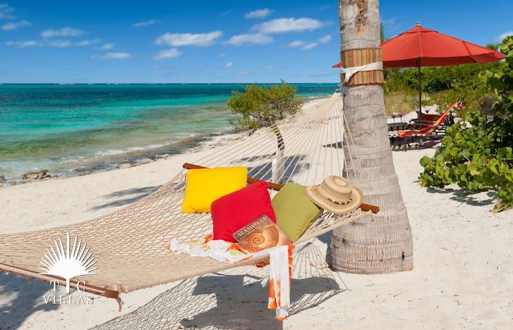 Turtle Beach Villa // Snorkeling, restaurants & activities just steps away!