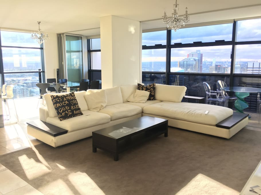 Large living room with amazing views of the city and Darling Harbour