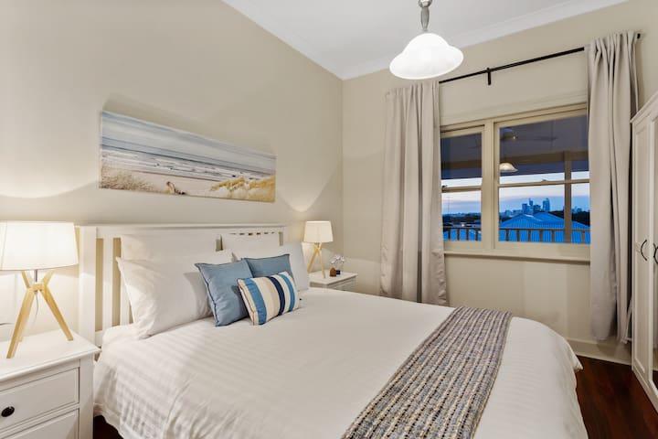 Beach theme bedroom overlooking the city