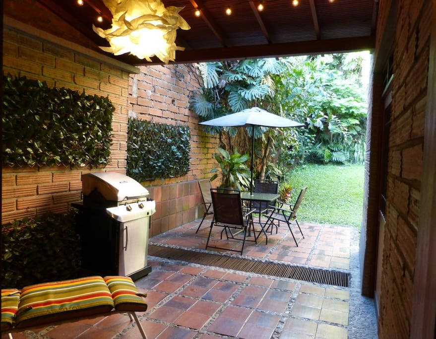 Private botanic garden with table and BBQ grill