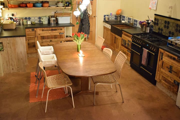 Kitchen/dining area - table can easily seat 8 people and we have 3 high chairs