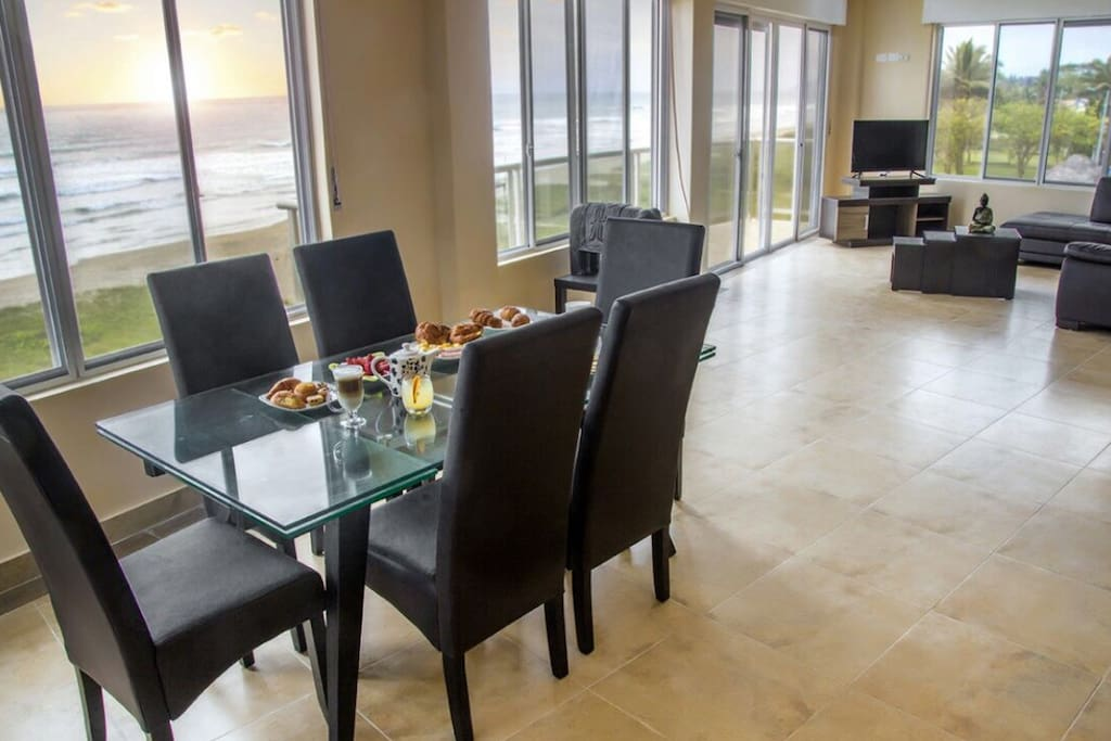 Dining and living room with panoramic ocean view. 180 degrees of the most incredible view.